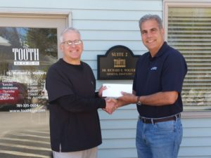 photo of Weymouth dentist Richard Wolfert, AKA The Toothboss, presents Richard DeLuca, owner of Deluca Properties in Weymouth, with the Smiling Neighbor Award.