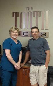 Photo of South Weymouth Dentist Richard Wolfert's Office Manager Deb Tower and Richard Bonanno of Rolling Wave Foundation